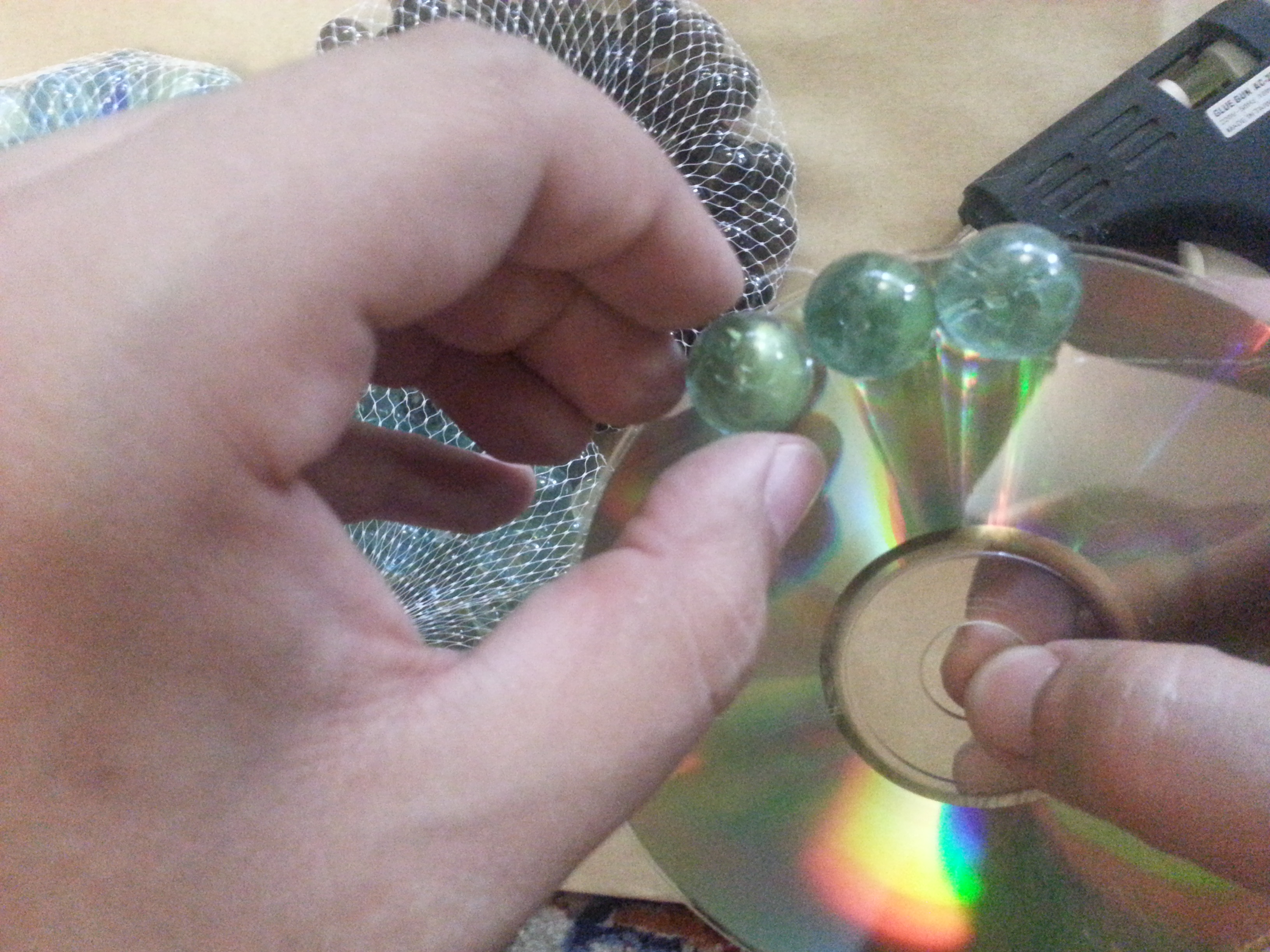 Picture of Determine the Number of Marbles Around the CD and Stick Them