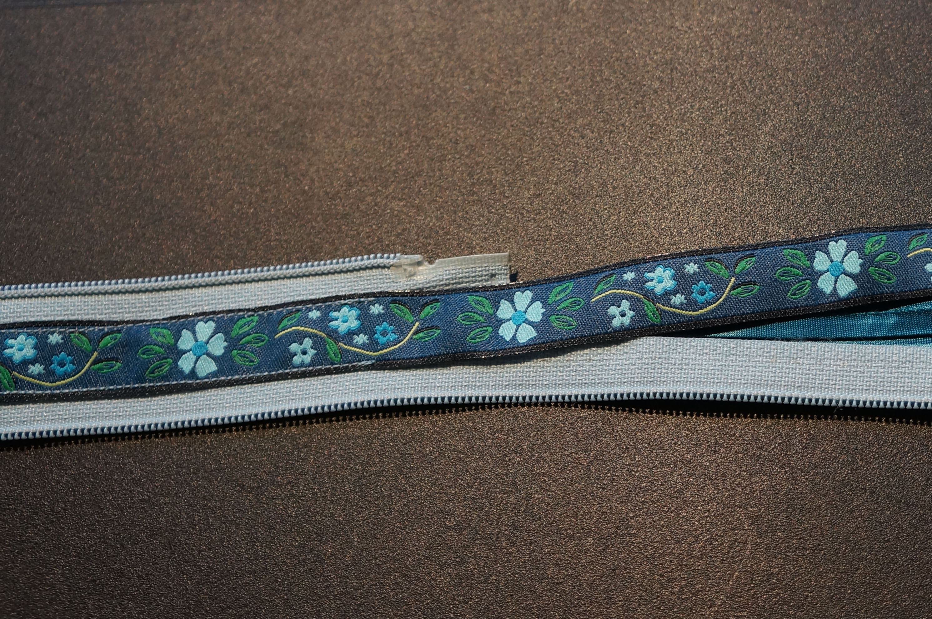 Picture of Stitch Ribbons to Zipper - the Long Straight (and Easy) Part