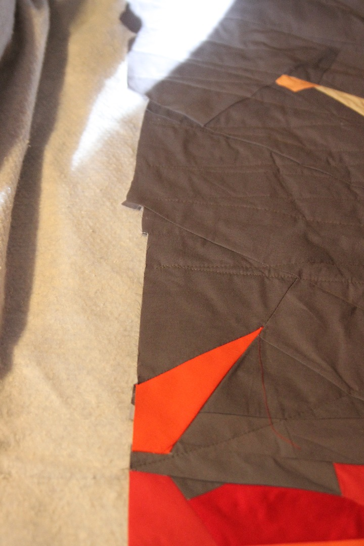 Picture of Spray Basting Your Quilt for at Home Quilting! Get to Quilting!