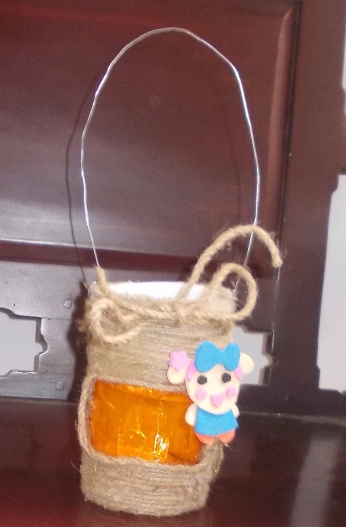 Picture of Glue Miss La Sen Onto the Lantern. Use the Big Hemp String to Make a Bow on the Top of the Lantern.