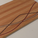 Cutting Board With Curved Inlay