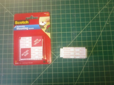 Apply the Removable Adhesive Mounting Squares