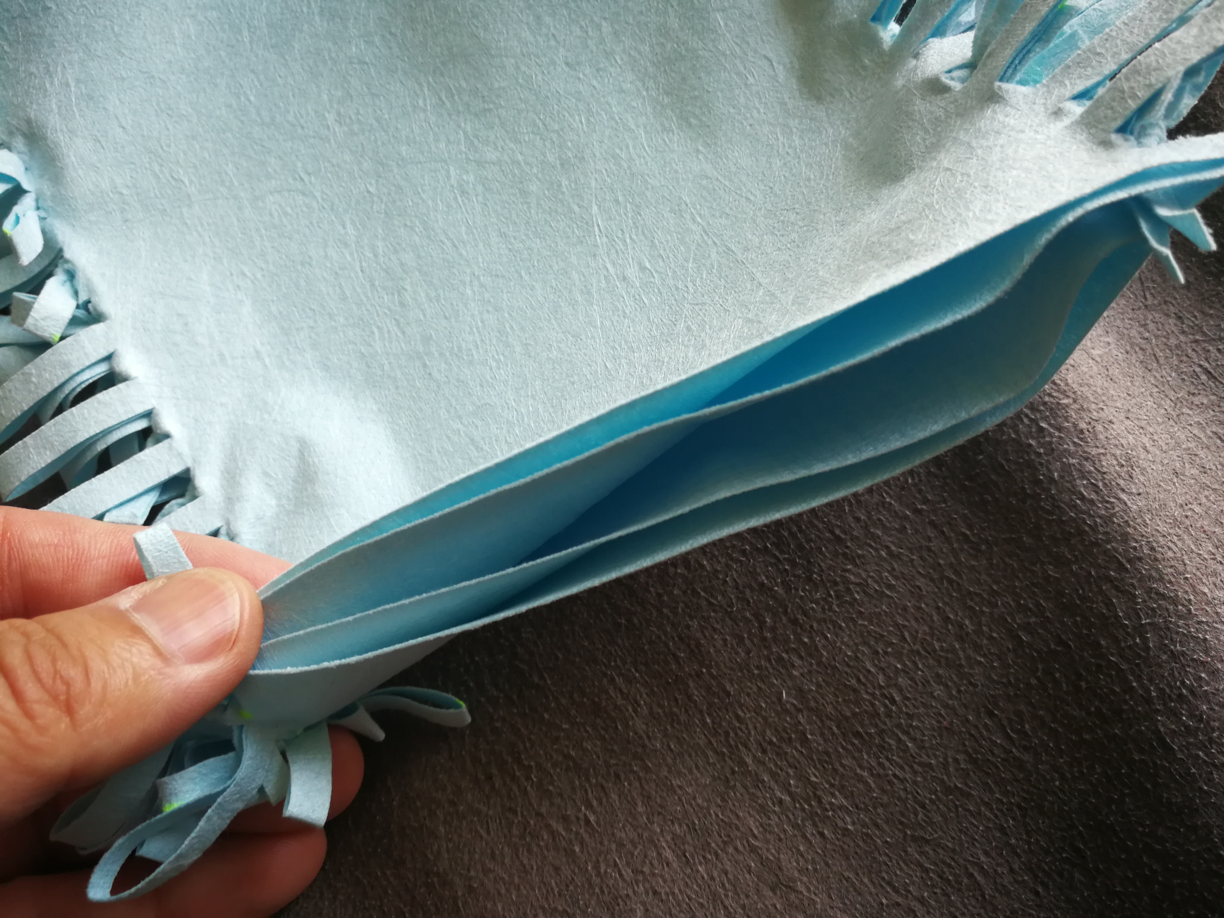 Picture of Tie Strips Together to Get the Cleaning Mitt