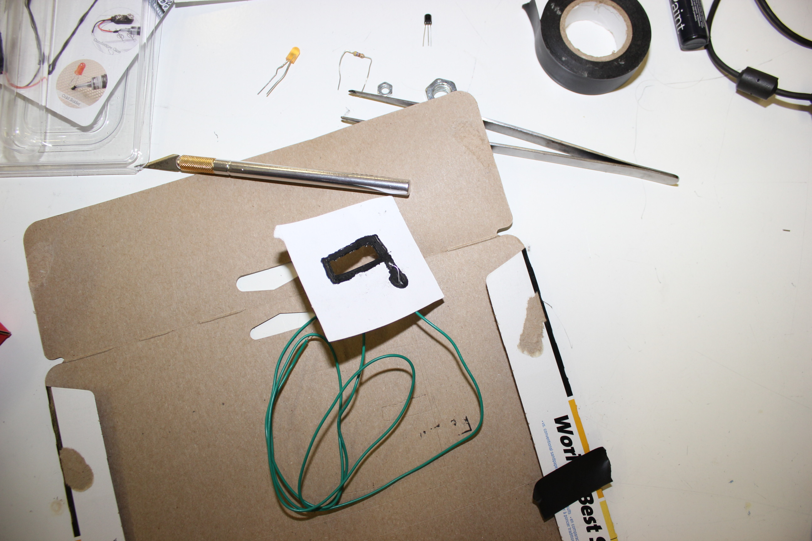 Picture of Step 004 - Attach the Wire to the Conductive Paint