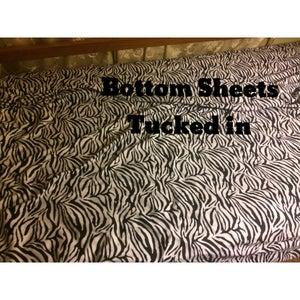 Tuck in Under the Bottom Mattress.
