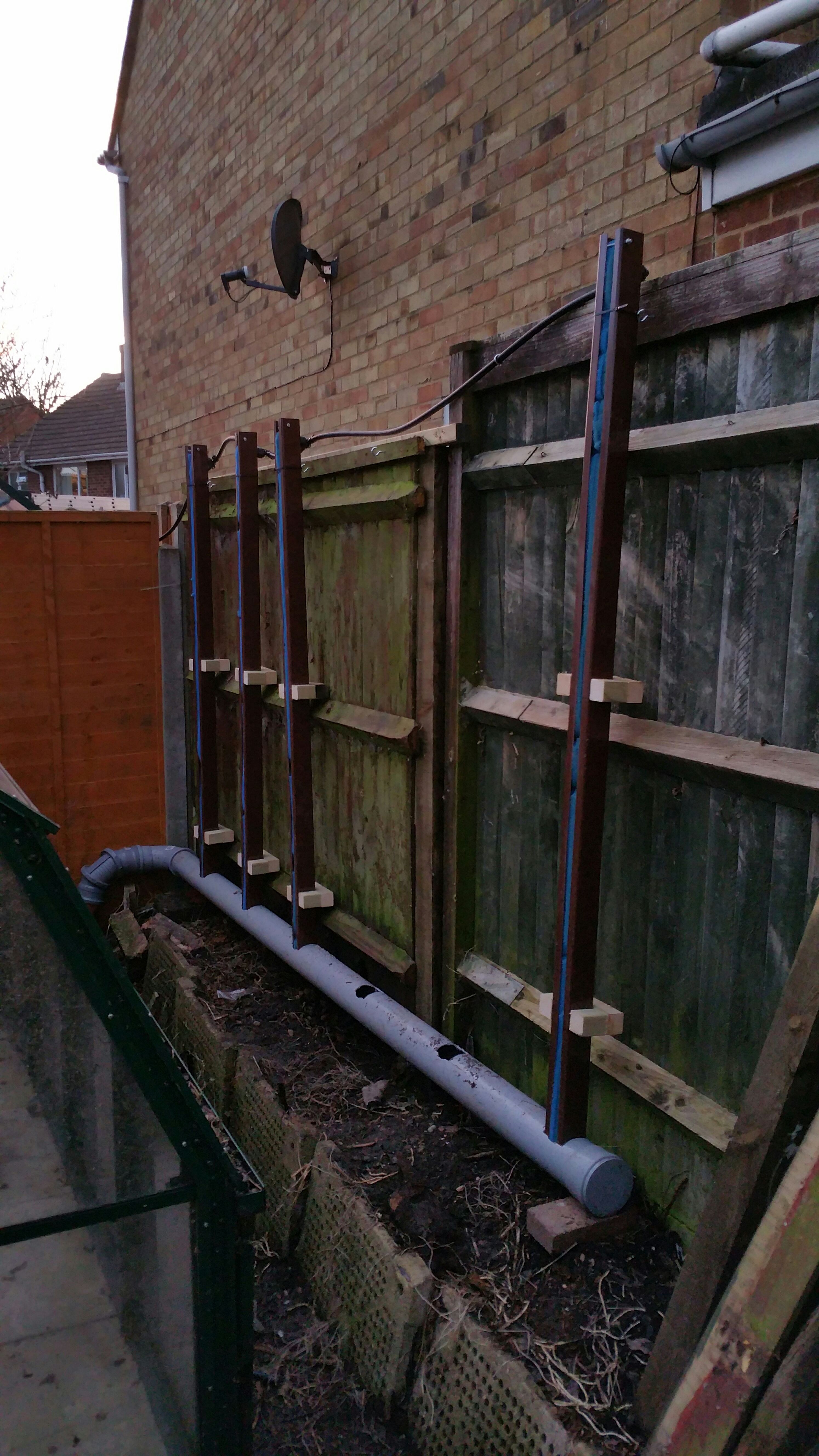 Picture of Inserting Filled Pipe Into Drainage/soil Pipe.