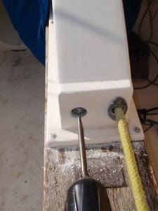 Drill New Hole in Centre Board Cover.