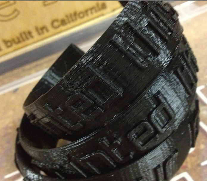 """Picture of 3D Printed Bracelets """"I Printed This"""" With Raised Lettering"""