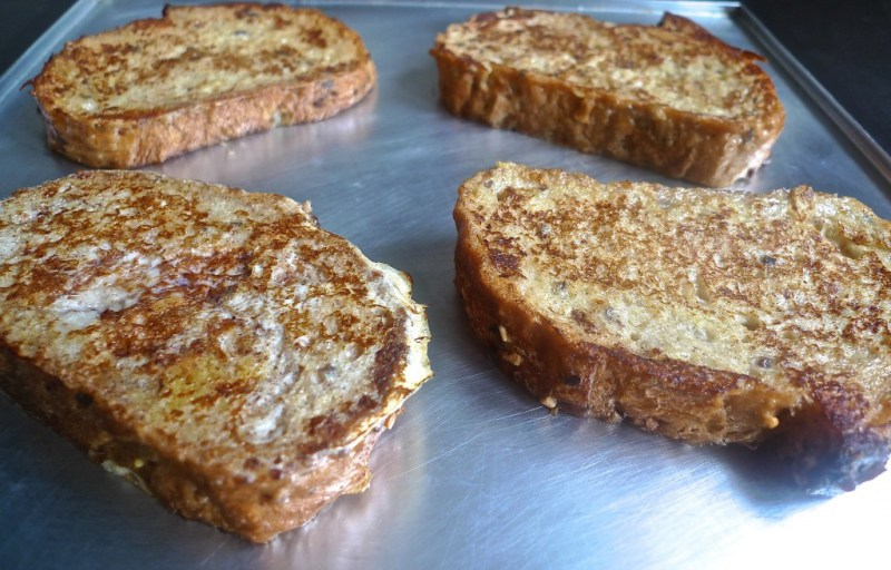 Picture of Transfer the Golden Brown Slices of French Bread to a Baking Sheet.