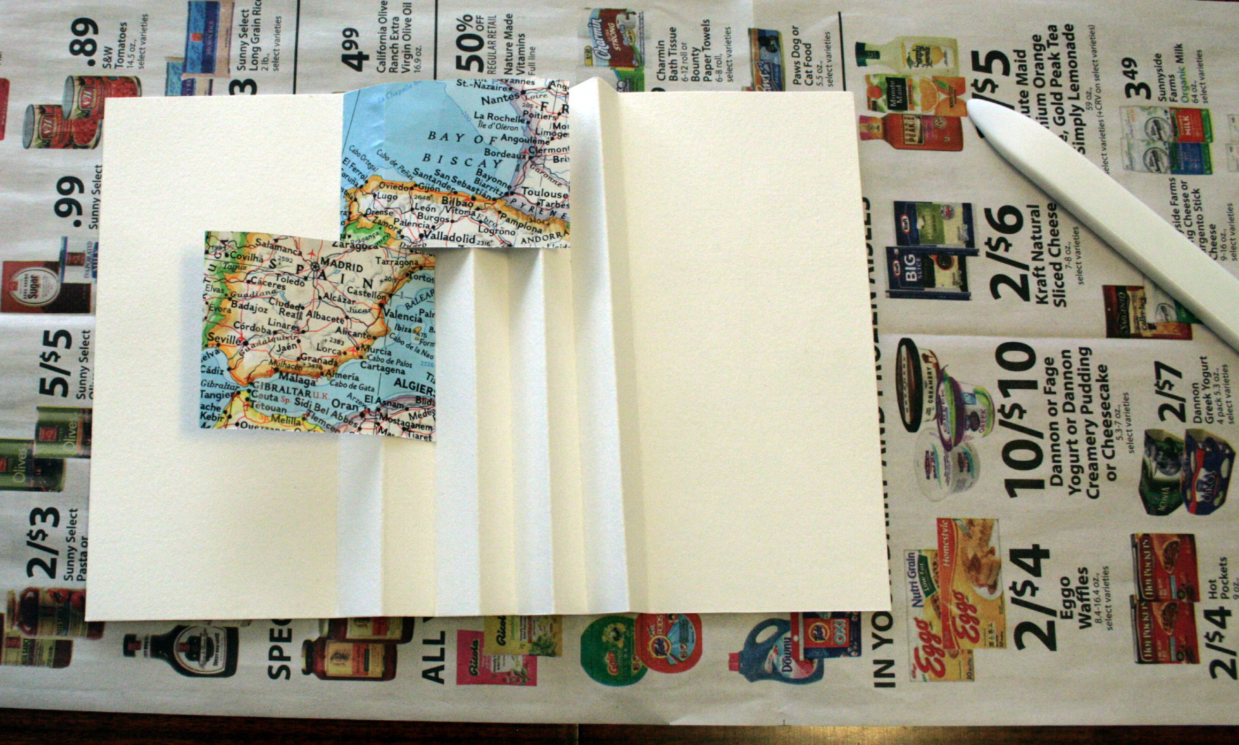 Picture of Step 9: Continue Gluing Down the Flags