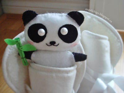 Sew a Panda With Felt Holding a Bamboo and Place Inside the Boots