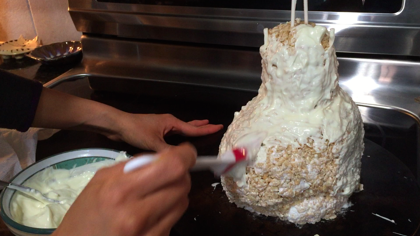 Picture of Coat the Bust in Melted White Chocolate, Then Allow the Bust to Set in the Fridge