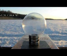 Frozen Soap Bubble on a Levitating and Spinning Magnet