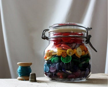 Use Empty Jars to Store Sewing Materials.