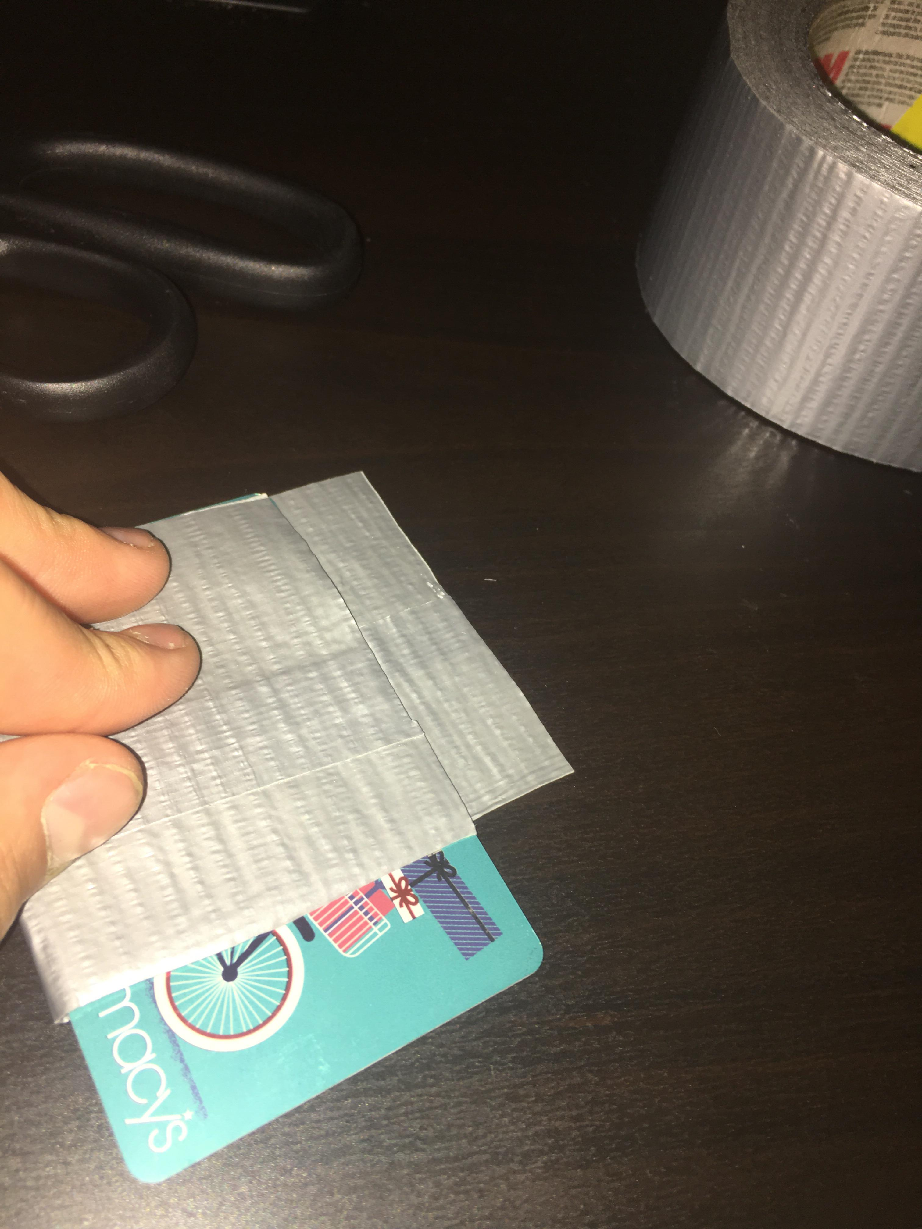 Picture of Fold Card Over With Tape and Cut Off Extra