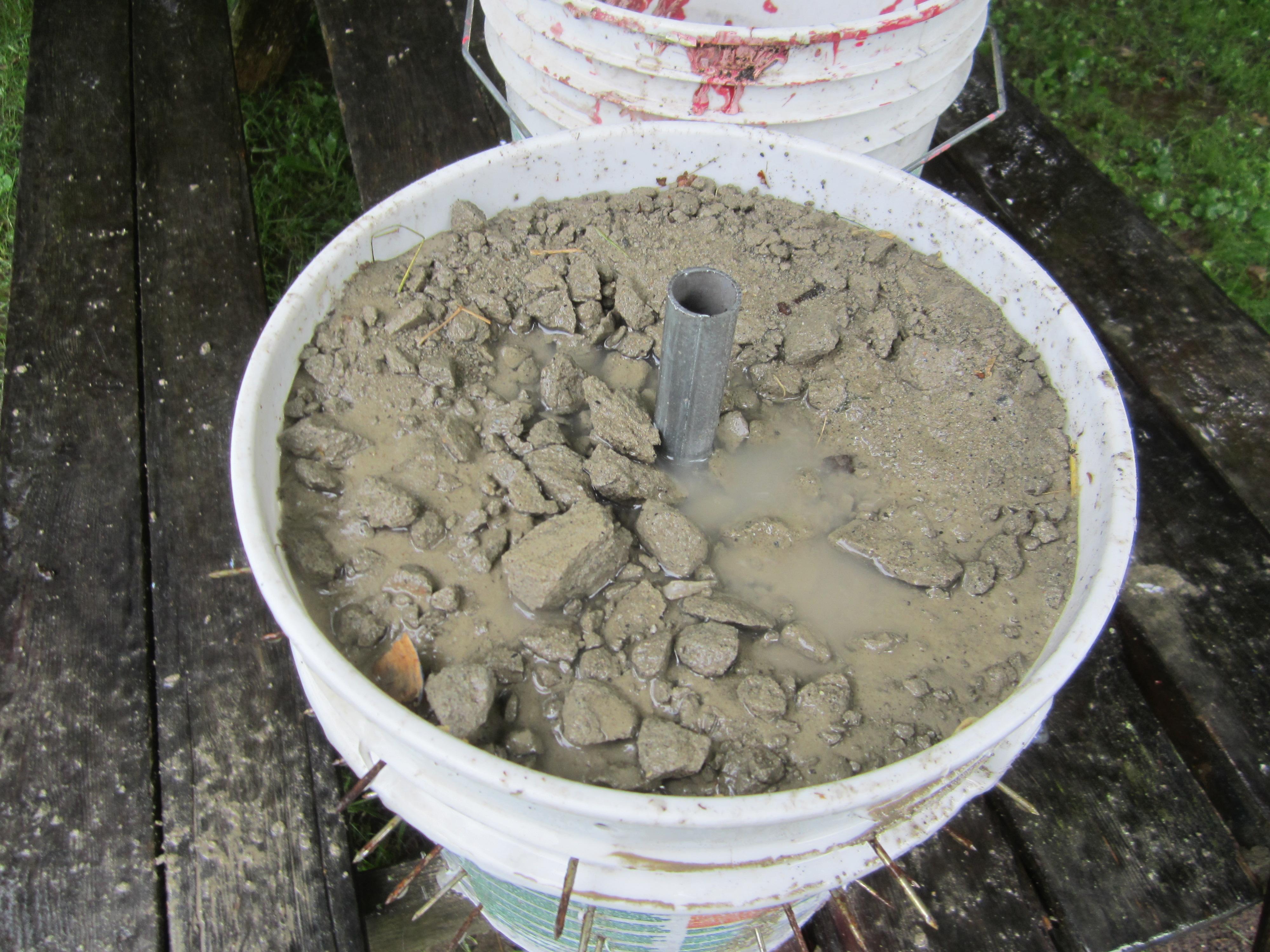 Picture of Put Pipe in Center; Add Concrete