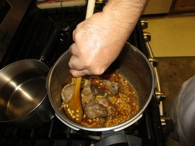 Adding the Spice Packet, Chana Dal and Hot Water.