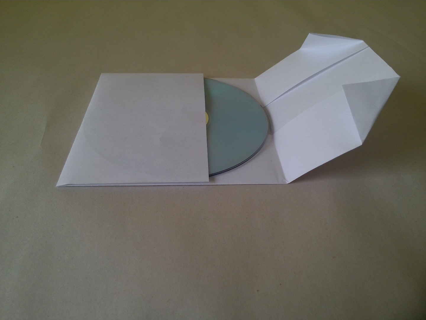 Picture of Remove the CD and Insert It Into the Slot the Two Bottom Flaps Make.