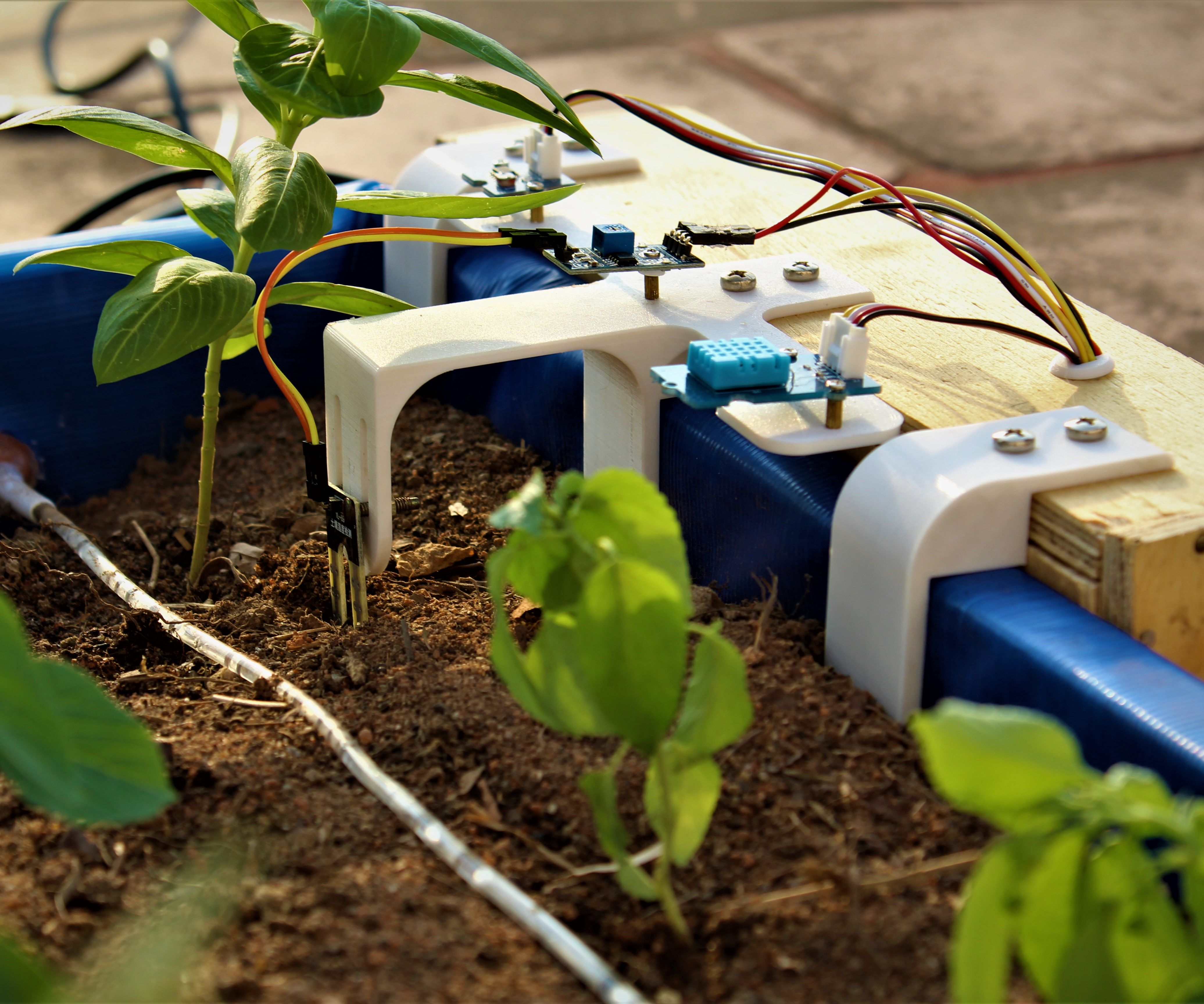 Smart indoor//outdoor watering solution system device with soil moisture sensor
