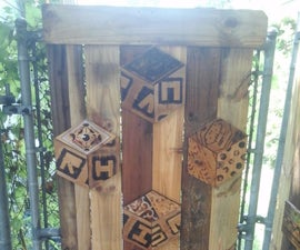 Add more privacy to chain-link fence with wood art