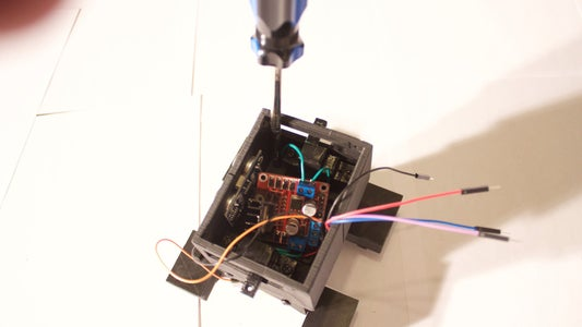 Add the Middle Pieces to the Base and Add the Range Sensor and Motor Driver.