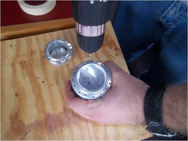Picture of Drill Holes in Bottom of One Can