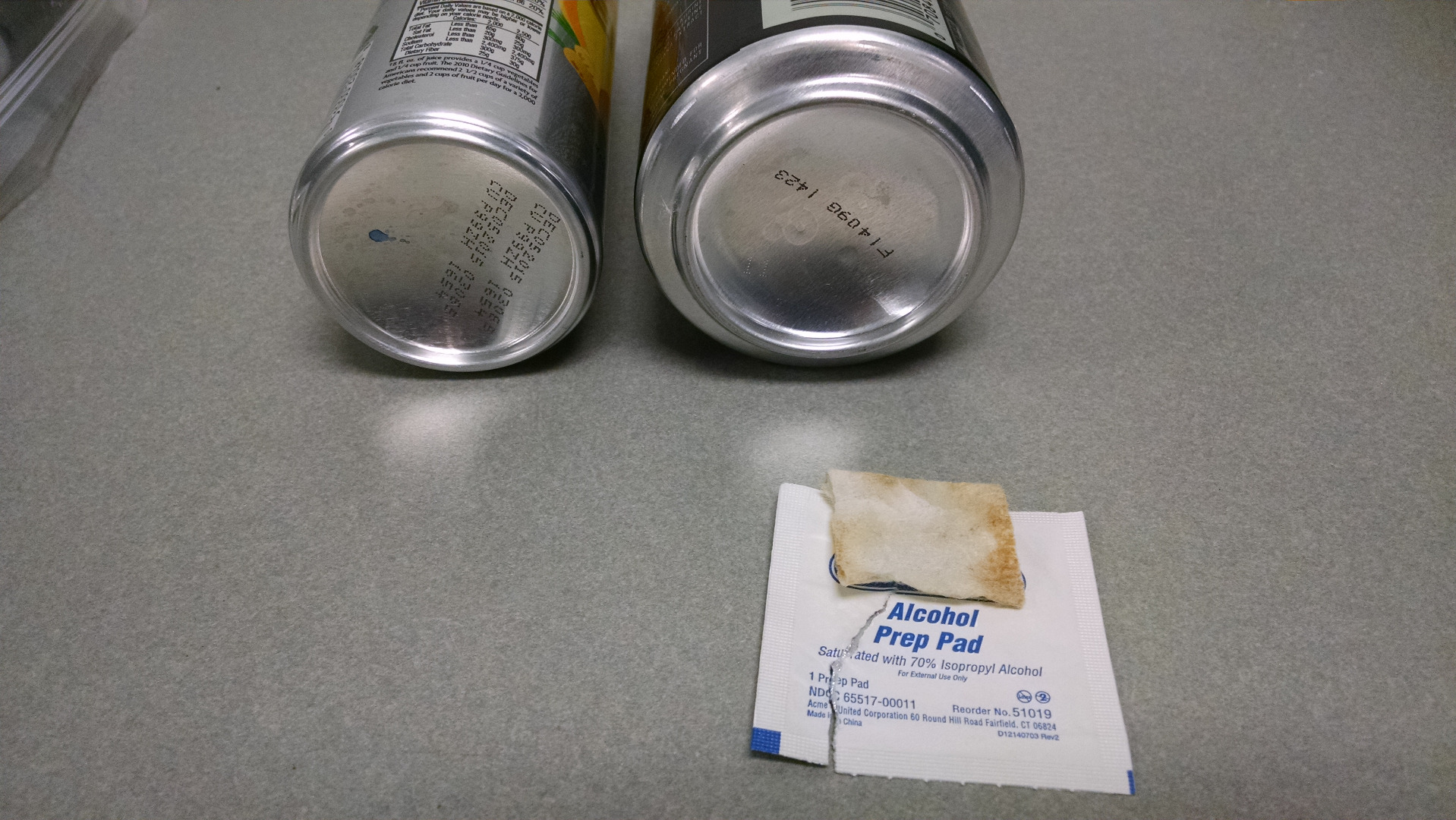 Picture of Clean, and File the Bottom of the Can Off