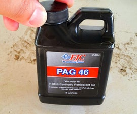Injecting Pag Oil Into a Car's Air Conditioning System.