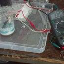 Create a rechargable 2 volt Aluminum/Titanium Ion Battery