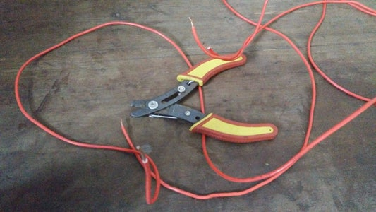 Strip the Ends of the Electric Wire Using Wire Stripper.