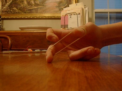 Place the Rubber Band on Your Fingers.