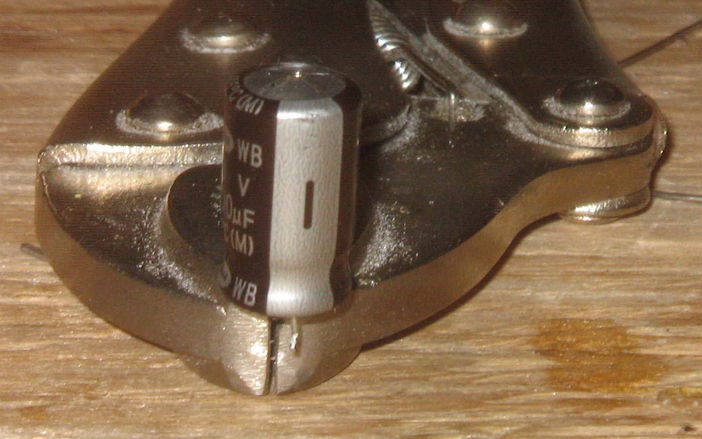Picture of Identify, De-Solder, and Remove the Failing Capacitors