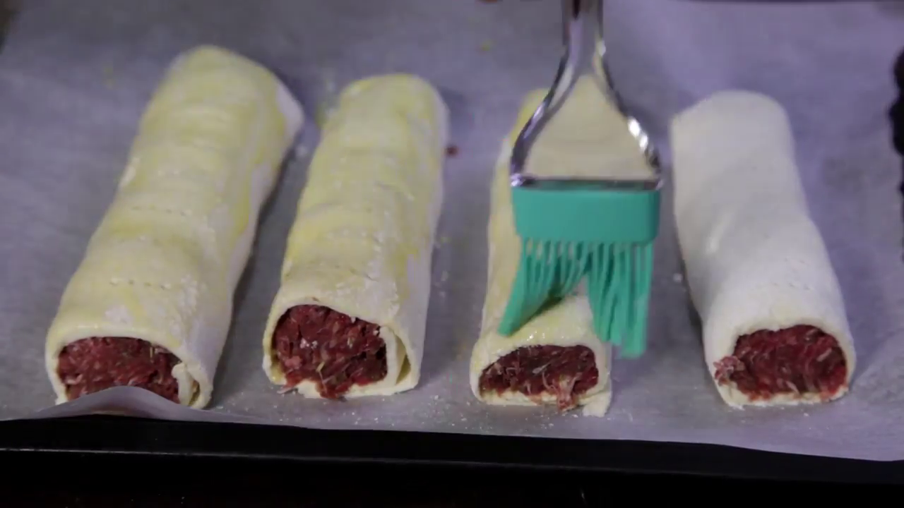 Picture of Using a Fork, Poke Air Holes One Cm Apart Along the Top of the Sausage Rolls.