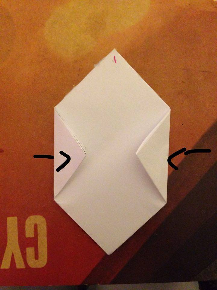 Picture of Flip Your Paper Over and Fold the Paper Over and Fold the Right and Left Corners Inwards So That They Meet in the Middle.