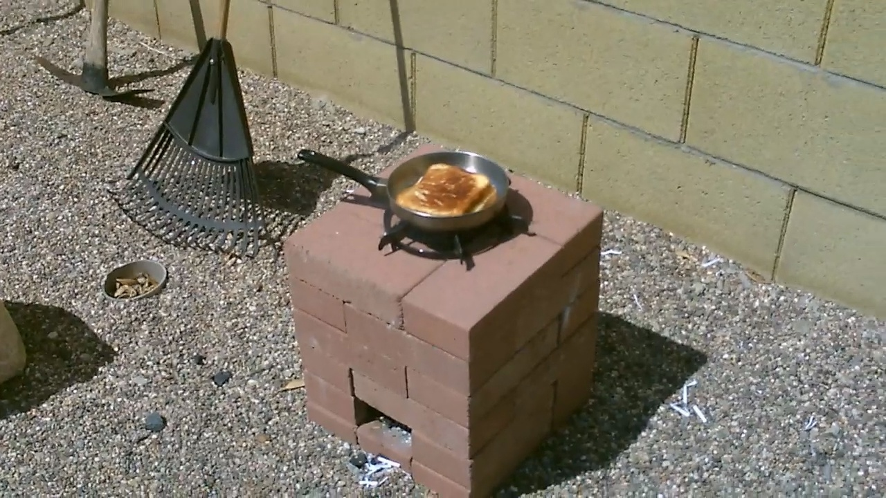 Picture of Cook Using Junk Mail - Make (Paper Logs) - Burn in a Rocket Stove! - Free Fuel!
