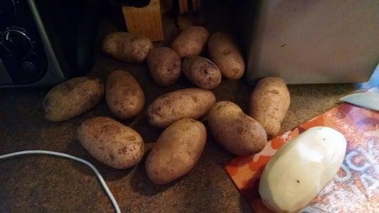 Peel and Cut Potatoes Into Semi Uniform Pieces