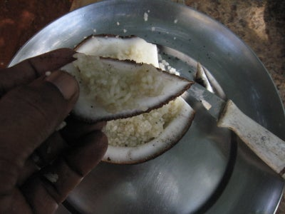 Cut Open and Eat Rice With Coconut