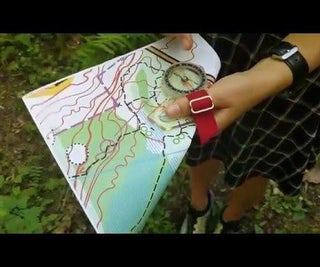 Orienteering Using a Thumb Compass