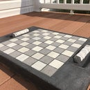 Concrete Checkerboard With Pieces
