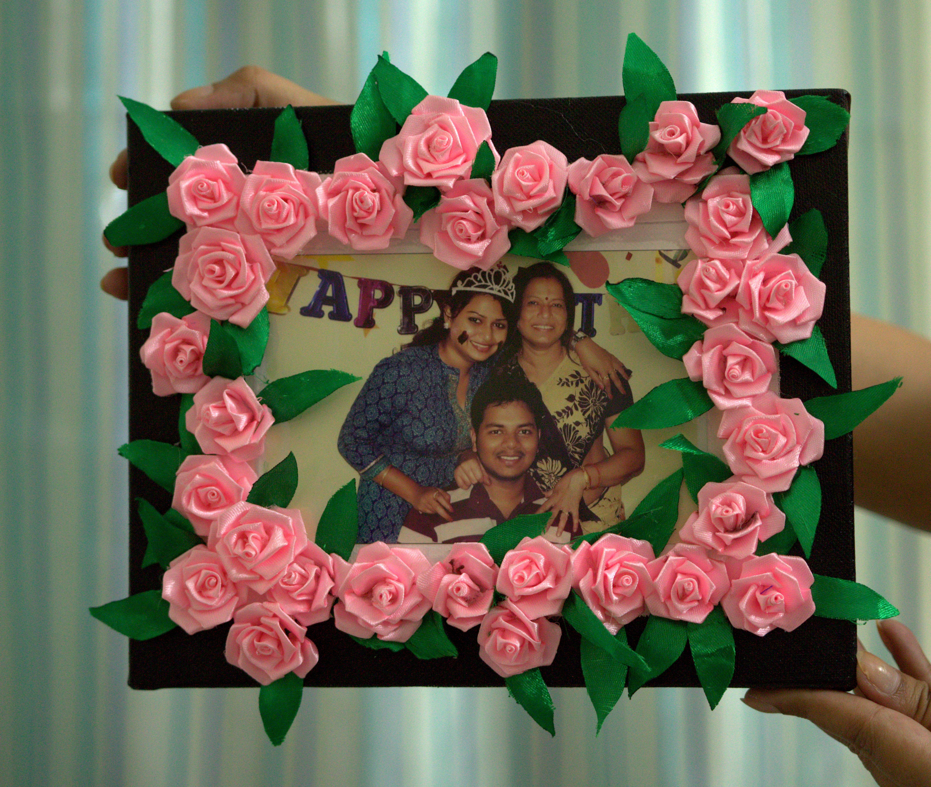 Picture of Gluing the Roses on the Frame