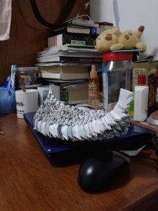 用三角折纸插成船的主体部分