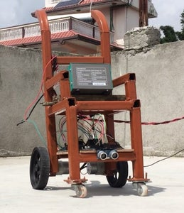 Joystick Controlled Wheelchair Aided With Obstacle Tracker
