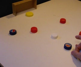 Table soccer game with bottle caps