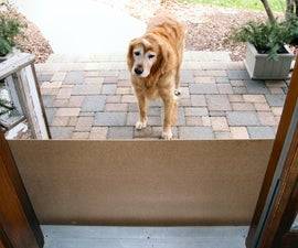 Sliding Dog Gate Protects Door from Scratches