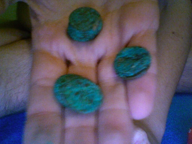 Picture of Old pennies stuck together with green rust like putty!?