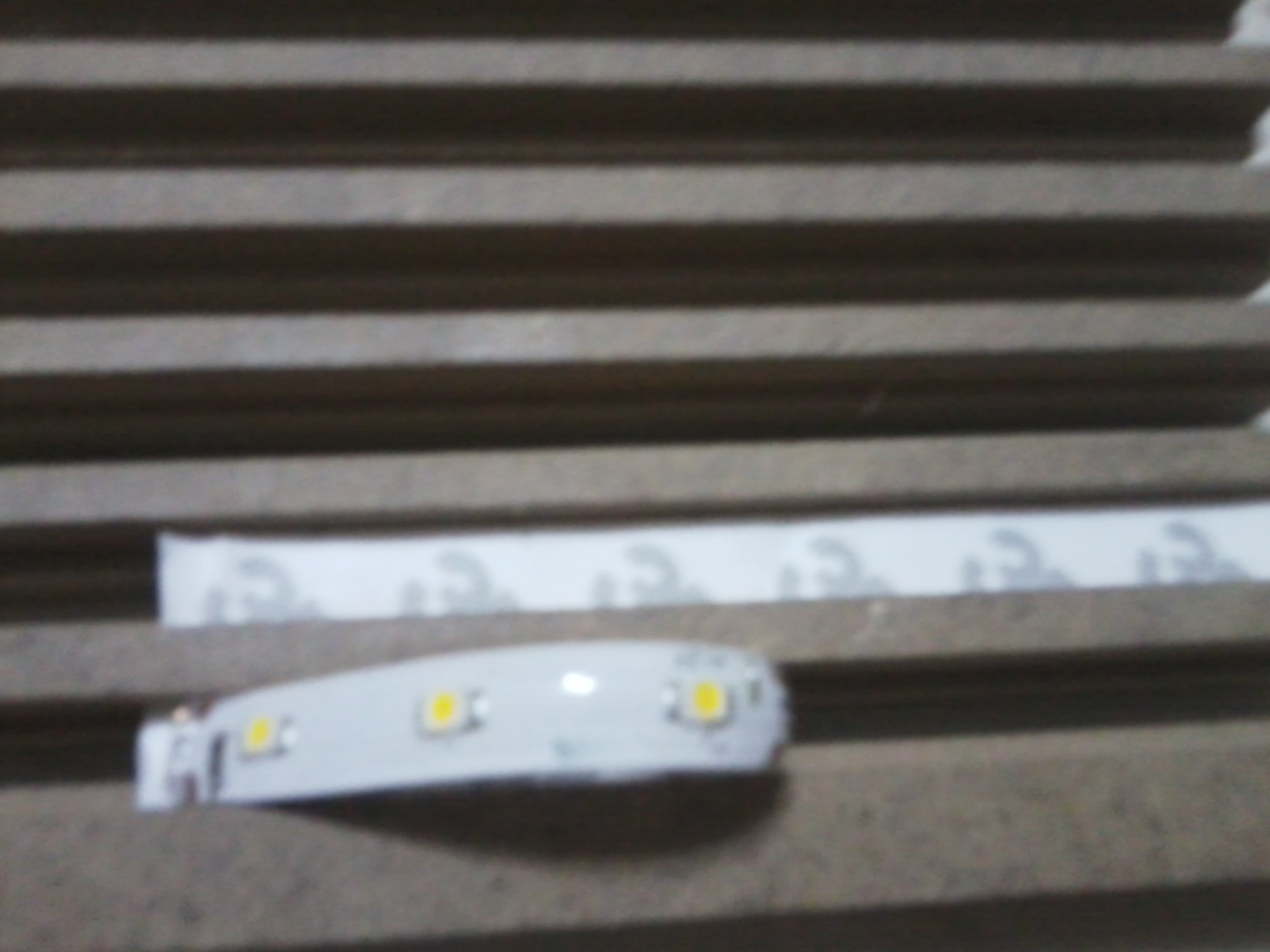Picture of Attaching LED Strips and Plexiglass Plates to the Wooden Piece