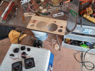 Opening Front Holes for the Speakers and Amplifier