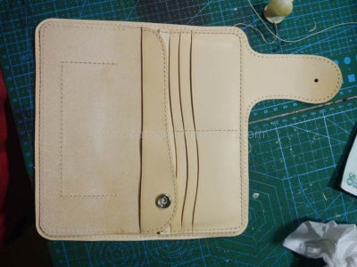 Install 201 Snap (socket and Cap) on Flap Strengthen Leather, and Then Sew It on Flap.