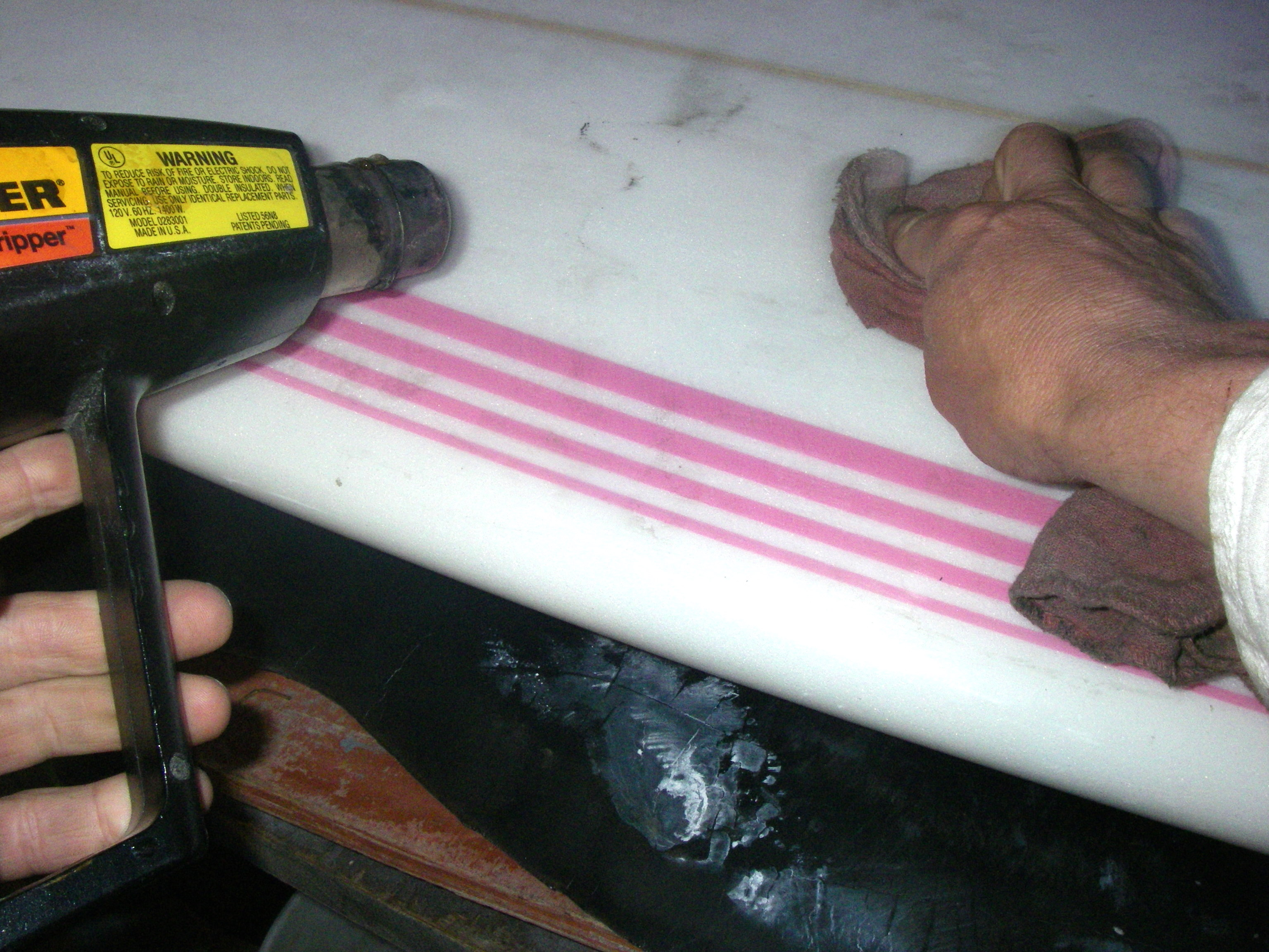 Picture of Heat Gun and Rag to Remove More Wax