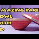 Paper strip bowl with old waste paper